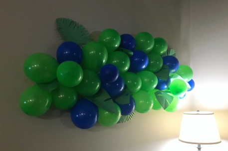 Balloon wall with leaves.